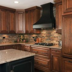 Stone Backsplash- want this on island and between top of cabinets to ceiling!