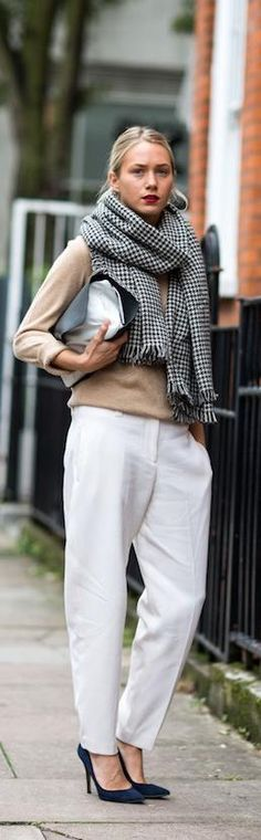 Tan knit + white wide leg trousers + navy courts + huge checked scarf + silver clutch