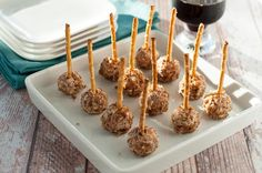 MIni Goat Cheese Balls skewered with a pretzel. Perfect party food for any season. Goat cheese, Pecorino cheese, cranberries and pecans. These disappear quickly! |www.flavourandsavour.com