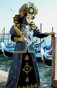 https://flic.kr/p/7ETwRG | Costumed character near the waterfront in Venice (P1000203a) | I went to to the Carnevale in Venice, Italy in February 2010 - what an absolute blast! I had the chance to shoot with an incredible number of people in gorgeous costumes and masks - it was a great experience and I'm already looking forward to going back there again.  I took this photo near the Doges Palace, Venice.