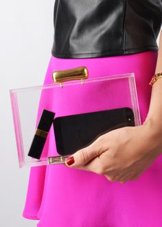 "Clear Lucite Clutch. Really? This reminds me of those clear plastic purses you had to carry if you worked at a department store. While the phone looks nice, i'm guessing the 2/3"" of pulverized crackers, three wadded tissues, and Wet n Wild lip gloss would not look as nice."