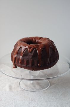 Sour Cream Chocolate Bundt ~  For the cake:  3 eggs  240g sour cream  55g best quality cocoa powder  2 tsp vanilla extract  230g plain flour  150g sugar  100g soft brown sugar  1 and 1/4 tsp baking powder  1/2 tsp baking soda  1/2 tsp salt  225g unsalted butter, at room temperature