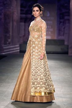 Gold embroidered jacket and lehenga set