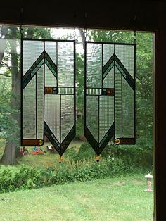 Glass panels by Julia Brandeis of Brandeis Glass Works, Westminster, VT, in Lake House sunroom.