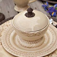 """The only way to eat porridge! A five and a quarter inch pedestal base bowl with a snug little lid topped with a bronze acorn finial. Cream finish and sold individually. brbrliDimensions: 5.25""""..."""
