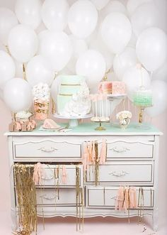putting balloons behind a buffet table and cake stand!