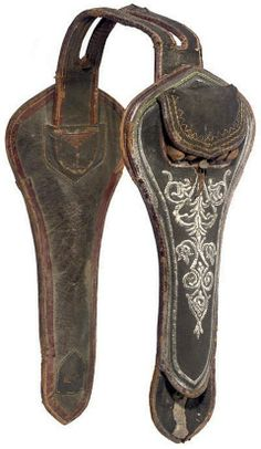 Ottoman saddle holster (kuburluk), early 19th century, leather and fabric construction, the outer face of each carrying five small tubular leather pouches for prepared cartridges, closed by a common cover and each retaining four original tubular metal cartridge-holders, and the holster bodies embroidered with silver wire foliage.