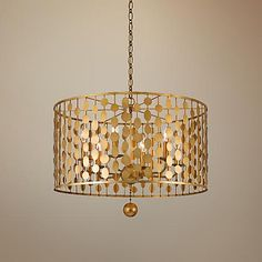 With a brilliant antique gold finish, this 6-light drum pendant has a chic, modern look.