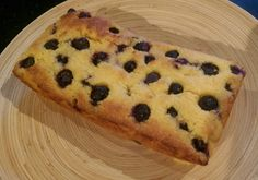 100g unsalted butter 100g caster sugar 90g polenta 100g ground almonds 2 eggs 100g blueberries 1 tsp baking powder 100ml yoghurt zest and juice of one lemon touch of milk if necessary Oven to 175 deg.  Line a loaf tin.  Cream sugar and butter. Whisk in eggs with some of the almonds.  Add lemon juice & zest, fold in polenta, rest of almonds, yoghurt, baking powder and half the  blueberries Add touch of milk, put in tin with rest of blueberries on top. Bake c. 45 mins, turn out when cool.