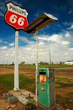 Phillips 66, Route 66 - note the staging error--- PHILLIP'S ha white and red pumps; Sinclair, with the dinosaur, had green pumps.
