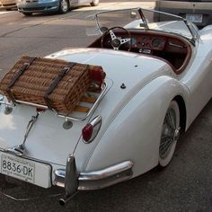 Jaguar, I'm more interest in the fact it has a picnic basket!