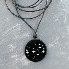 Black onyx stone pendant, engraved with the Pleiades.