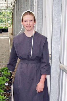 Amish Girl at Nursery---im 45(so im not an old geezer) and i say how refreshing it is to see a girl of this age with natural beauty..not made up and dressed like a tart...this is true beauty