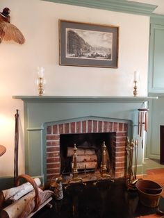 Wow...maybe buy a Tudor stone surround, then tile the inner ...