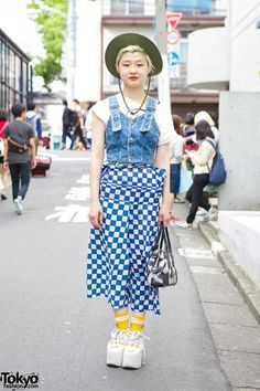 Ayano is a 20-year-old hair salon staffer who we often see around #Harajuku. Her look here features a resale denim bustier with a #Comme #des #Garçons checkered skirt and Belly Button (by #Tokyo #Bopper) platform shoes. #tokyofashion #street snaps