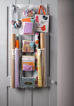 Homes Organisation: Giftwrap and tags hung on the back of a door