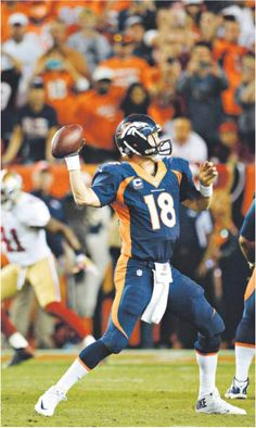 Peyton Manning, Broncos quarterback, topples record set by Bret Favre with 510 touchdowns, six games into the season.