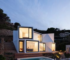 cadaval & solà morales protrudes sunflower house from mediterranean cliffside