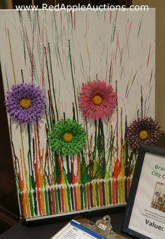At a nonprofit auction (not a school auction), this client-made crayon art sold. Learn about 100+ more ideas like this at http://www.redappleauctions.com/benefit-auction-webinars/cool-class-projects/