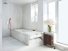 The master bath is equipped with a Kohler tub | archdigest.com