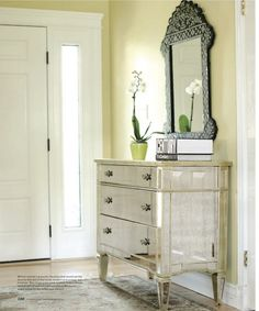 Use a dresser rather than a table in an entryway to gain extra storage space, need a big rug