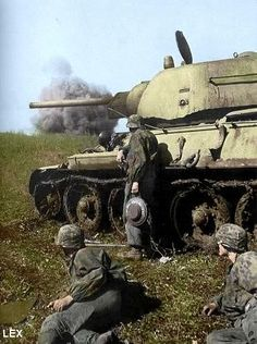 Waffen SS grenadiers next to a Soviet T-34 medium tank.