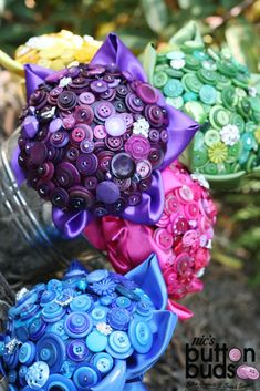 Rainbow Button Bouquets - Blue, Green, Yellow, Purple & Pink.    Nic's Button Buds - www.mybuttonbouquet.com  For the bride that dares to be different  Button Bouquets, Brooch Bouquets, Mixed Media Bouquets & other wedding accessories.