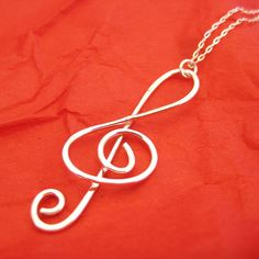Simple and elegant for the music lover... make your own with craft wire.  Hammer it or not.