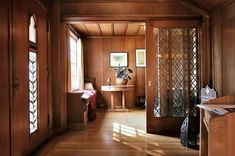 The home's main level features hardwood floors throughout and leaded-glass doors. Photo: Liz Rusby