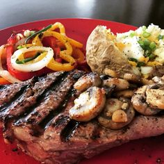 Grilled New York Strip Steak topped with Sautéed Mushrooms, Grilled Peppers & Onions and Loaded Baked Potato