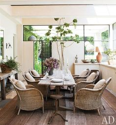 Sunroom - great combo rattan chairs and distressed table