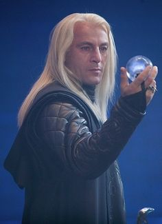 Lucius Malfoy holding The Prophecy