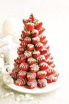 White chocolate drizzled strawberries.  Insert toothpick at stem  stick on styrofoam cone starting at base.