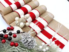 Welcome to HotCocoaDesign! Country chic table runner to decorate your rustic Holliday table or for any other occasion. Made of natural burlap and decorated in the middle with red and white French stripes applique,the runner has the edges overlocked (serged) for extra durability and