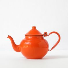 I already own this lovely tea pot as it was passed down to me from my mama several years ago!  Vintage Orange Enamel Teapot - Enamelware on Etsy, $25.00
