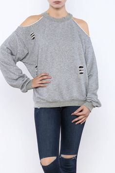 Grey sweatshirt with a crew neck, cold shoulders, back cut out and distressed detailing. Distressed Sweater by Honey Punch. Clothing - Sweaters - Crew & Scoop Neck Clothing - Sweaters - Sweatshirts & Hoodies New York City Manhattan, New York City