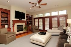LIVING ROOM (19' x 17') - Spacious living area with wall of French doors which open to balcony overlooking green space across the street. Fireplace with gas logs flanked by built-in bookcases. High ceilings, hardwood floors & lots of natural light.