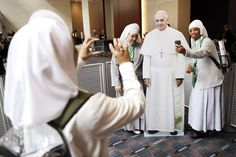 Nuns with the Hospitaler Sisters of Mercy in Pleasantville, N.J., pose for a selfie with a cutout of Pope Francis, at the World Meeting of Families conference in Philadelphia.