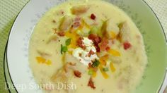 Loaded Baked Potato Soup - A thick and creamy soup with all the goodness of a loaded baked potato - bacon, butter, sour cream, cheddar cheese and green onion.