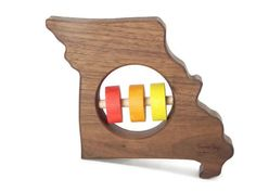 State Rattles by BannorToys on Etsy. They need a Florida one.