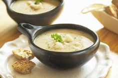 This cauliflower soup recipe includes parmesan cheese, which gives it richness and tang. Pureed in a blender, this cauliflower soup recipe turns out velvety and smooth. A sprinkle of cheesy croutons on top dresses up a bowl of this cauliflower soup. Cauliflower Cheese Soups, Creamy Cauliflower, Cauliflower Recipes, Parmesan Cauliflower, Low Carb Recipes, Vegan Recipes, Cooking Recipes, Vegan Soups, Vegan Meals