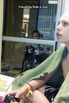 Two boys find a way to hang out on a pediatric oncology unit.