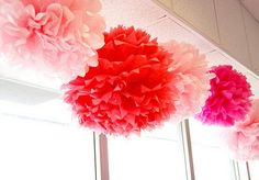 Tissue Paper Pom Poms. Super cheap and easy to make. These have been my new go to when planning parties!