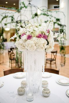 elegant tall centerpiece - photo by Emily Millay Photography http://ruffledblog.com/candy-colored-wedding-inspiration-in-charlotte #centerpieces #hydrangeas