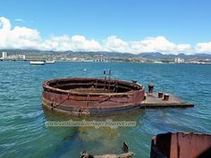 Remaining part of the USS Arizona. Very sad. You can still see the oil on top of the water from the ship. They say it is from all the soldiers that didn't make it out of the ship, because they still cannot find the source of the oil.