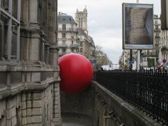 The RedBall Project at Paris Hotel de Ville - photo by Denis (tofz4u), via Flickr;  installation by Kurt Perschke