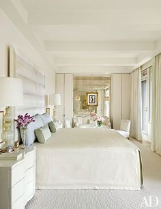 Elegant vintage lamps flank an understated bed in the serene, off-white master suite of a Washington, D.C., apartment by Solis Betancourt & Sherrill. | archdigest.com