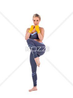 ready to kick - A sporty woman ready to kick