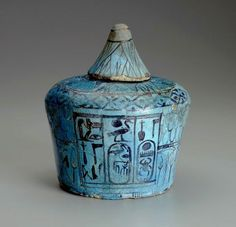 Blue faience Nemset jar (funerary vessel) from the tomb equipment of Thutmose IV. The jar is decorated with the titulatury of the king. The lid is in the shape of a lotus flower.     Egypt, New Kingdom. Reign of Thutmose IV, 18th Dynasty - ca. 1400-1390 B.C.