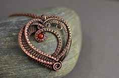 This elegant and sophisticated wire wrapped copper heart pendant is designed and made by me with stunning natural carnelian gemstone bead.  This